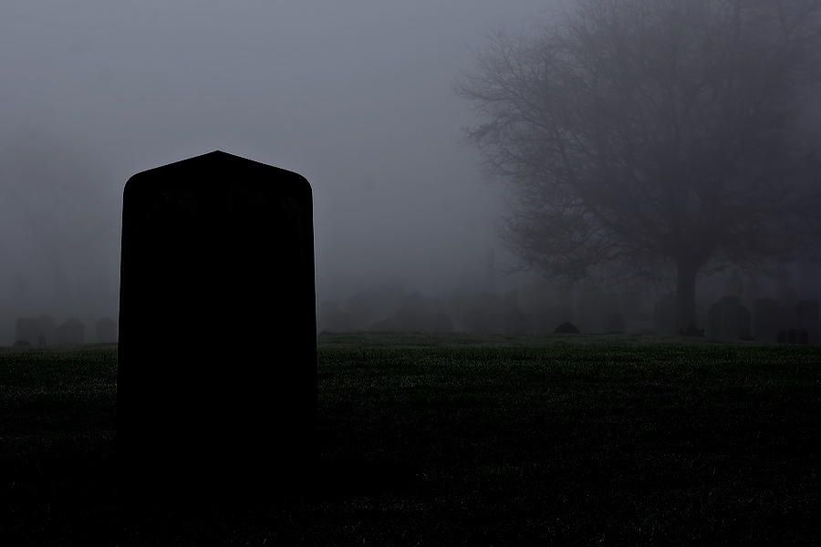 single-gravestone-in-a-spooky-graveyard-on-a-foggy-day-ken-biggs.jpg