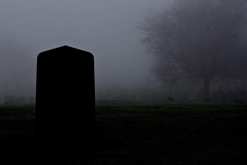 single-gravestone-in-a-spooky-graveyard-on-a-foggy-day-ken-biggs.jpg